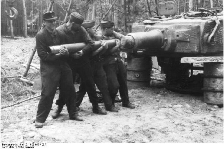 Men of the Werkstattkompanie struggle to pull the gun tube from the turret of Tiger 912, Bacau, Romania,June 1944
